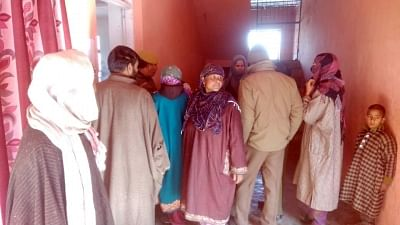 Budgam: Voters wait outside to cast their votes during the first phase of the Jammu and Kashmir panchayat elections at Khan Sahib village in Jammu and Kashmir