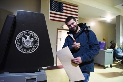 NEW YORK, Nov. 6, 2018 (Xinhua) -- A voter gestures after casting his ballot at a polling station in Staten Island of New York, the United States, on Nov. 6, 2018. U.S. voters began to cast their ballots in the midterm elections as the first polling stations opened Tuesday morning. (Xinhua/Han Fang/IANS)