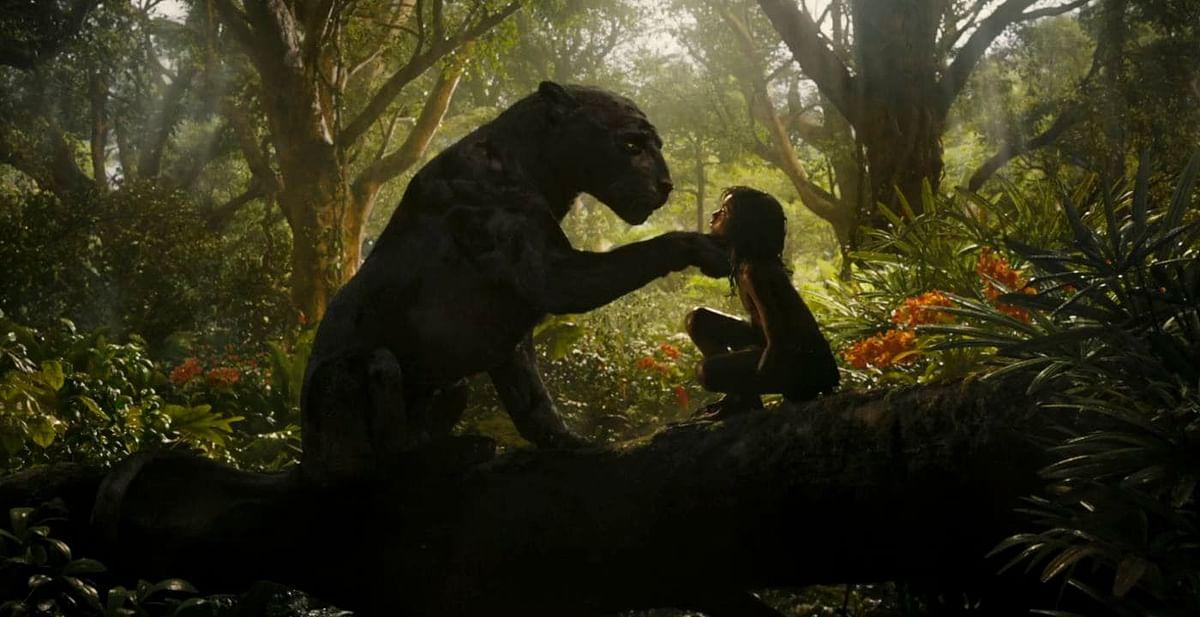 Rohan Chand as Mowgli with Christian Bale as Bagheera in Netflix's <i>Mowgli</i>