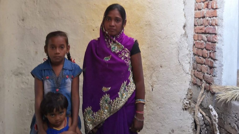 Kekti Verma with two of her three daughters. She is yet to receive any help from the government since her husband Dhal Singh Verma, a farmer, committed suicide in 2017 in Sararidih, Chhattisgarh. He had a loan of Rs 600,000.