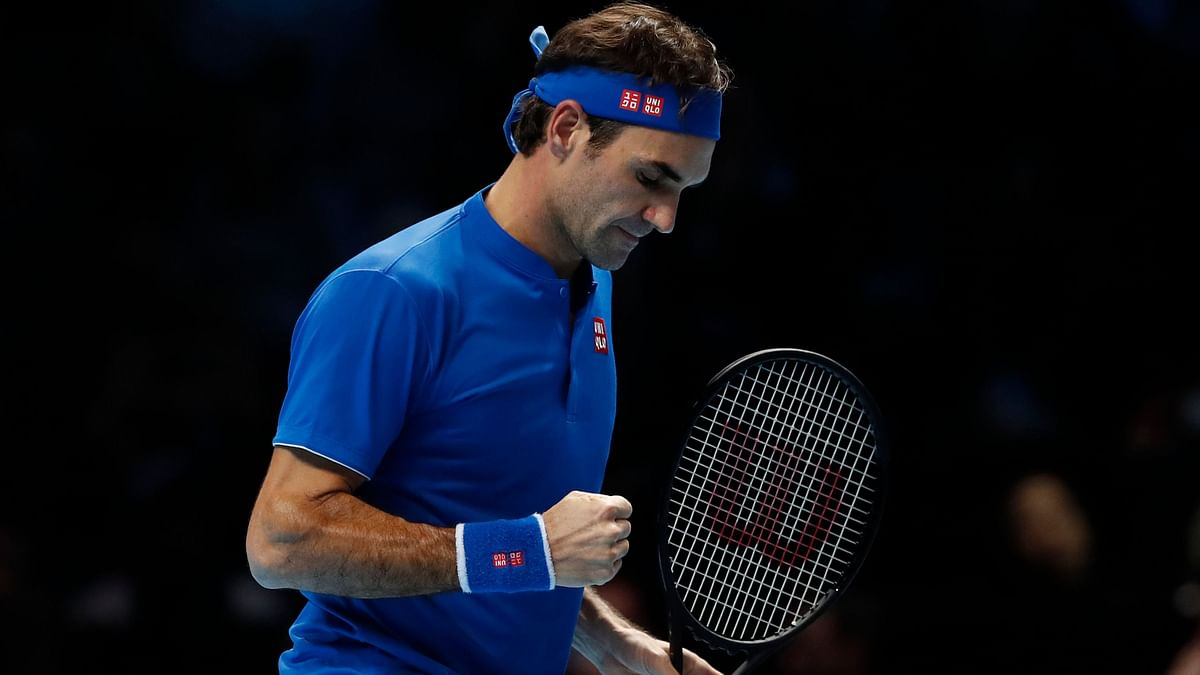 Roger Federer celebrates a point during his win over Dominic Thiem at the ATP Finals