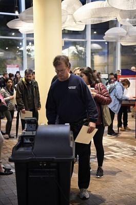 ARLINGTON, Nov. 6, 2018 (Xinhua) -- A man casts his vote during the U.S. Midterm Elections at a polling place in Arlington, Virginia, the United States, Nov. 6, 2018. (Xinhua/Liu Jie/IANS)