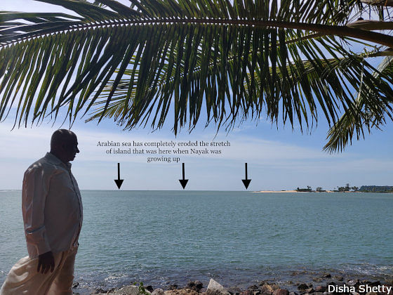 TH Nayak's extended family owned land on the Pavinakurve island (in background), which has now been eroded by the Arabian sea in northwestern Karnataka.