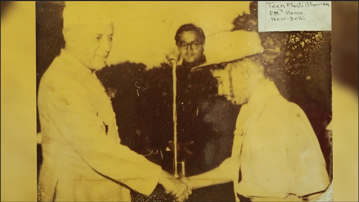 14-year-old Harish Mehra with Jawaharlal Nehru after receiving his Bravery Award on 3 Ferbruary 1958.