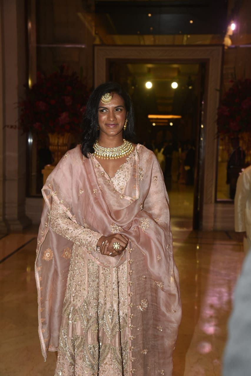 PV Sindhu arrives at The Leela Palace dressed in pink.