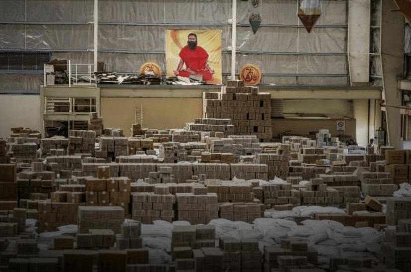 A poster depicting yoga guru Baba Ramdev is displayed inside a warehouse operated by Patanjali Ayurved Ltd. near to the Multi-modal International Cargo Hub Airport at Nagpur (MIHAN) in Nagpur.
