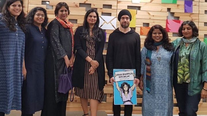 The photo that received all the backlash. Jack Dorsey can be seen holding the poster.