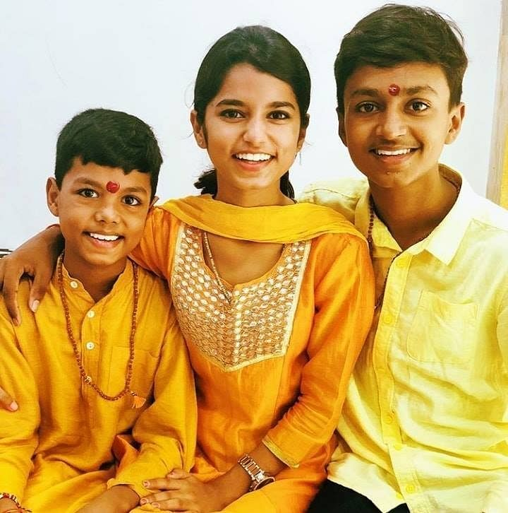 Maithli with her younger brothers, Rishav and Ayachi.