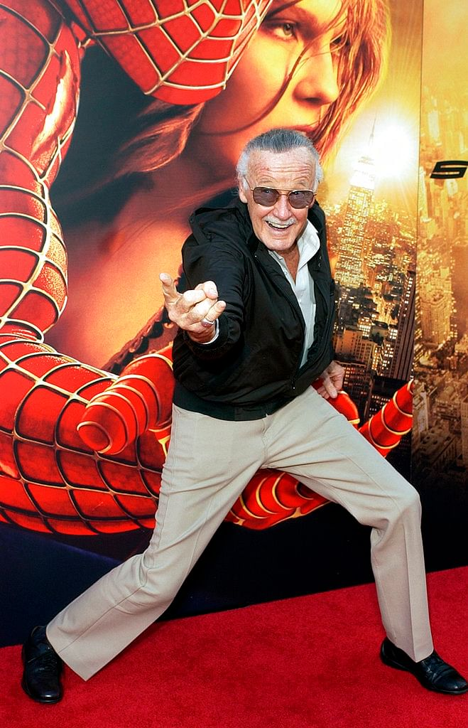 """In this 22 June 2004 photo, Spiderman creator and <i>Spider-Man 2</i> executive producer Stan Lee poses for photographers at the premiere of """"Spider-Man 2"""" in Los Angeles. &nbsp;"""