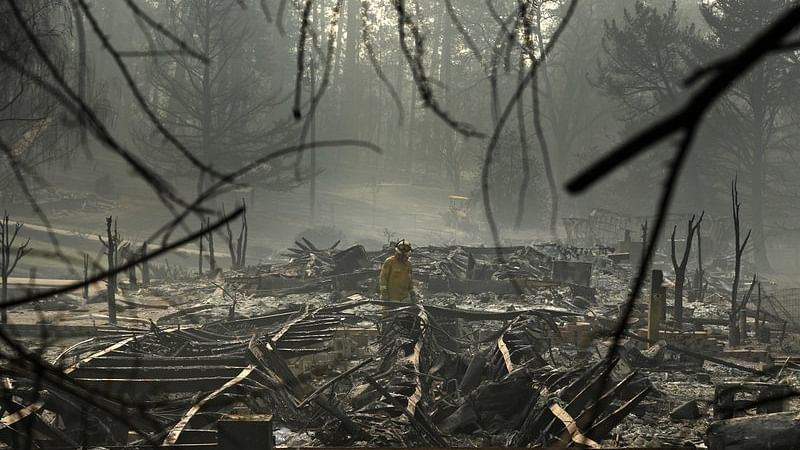 Authorities in Northern California on Friday searched for those who perished and those who survived the fiercest of wildfires ahead of a planned visit by President Donald Trump.