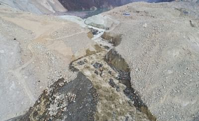 CHANGDU, Nov. 13, 2018 (Xinhua) -- Aerial photo taken on Nov. 13, 2018 shows water of a landslide-caused barrier lake on the Jinsha River flows through a drainage channel in the border area between Sichuan Province and Tibet Autonomous Region in southwest China. A drainage channel constructed by disaster relief staff successfully resumed the flow of Jinsha River, which had been blocked by a barrier lake formed following a landslide that hit the area on Nov. 3.    (Xinhua/Feng Yunhu/IANS)