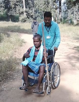 Sukma: A wheel chair bound voter being assisted to a polling booth during the 1st phase of Chhattisgarh Assembly Elections, in Sukma on Nov 12, 2018. (Photo: IANS/PIB)