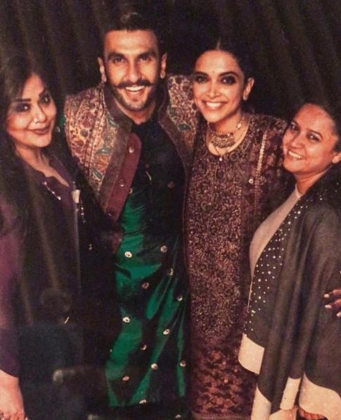 Deepika Padukone and Ranveer Singh in colour coordinated Sabyasachi designs.