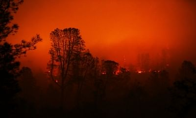 PARADISE, Nov. 14, 2018 (Xinhua) -- Wildfire burns in Oroville, California, the United States, on Nov. 13, 2018. The death toll from the raging Camp Fire in the U.S. state of California has increased to 48 as rescuers continue to search for missing residents in and around the town of Paradise, local authorities said Tuesday. (Xinhua/Li Ying/IANS)