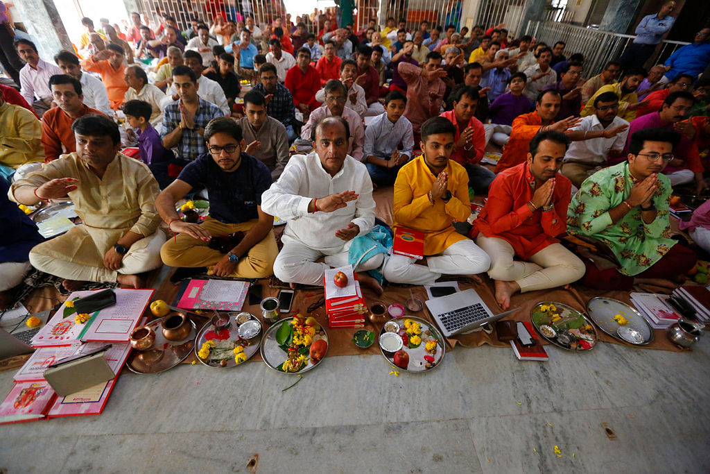 Traders performs rituals during Chopada Pujan or a mass prayer ceremony dedicated to the worship of the account books, on the occasion of Diwali, the Hindu festival of lights, at the Swaminarayan temple in Ahmadabad.