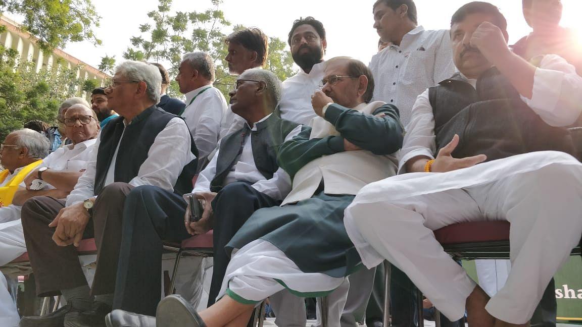 Sharad Yadav, accompanied with D Raja and Sharad Yadav at the Kisan Marc.