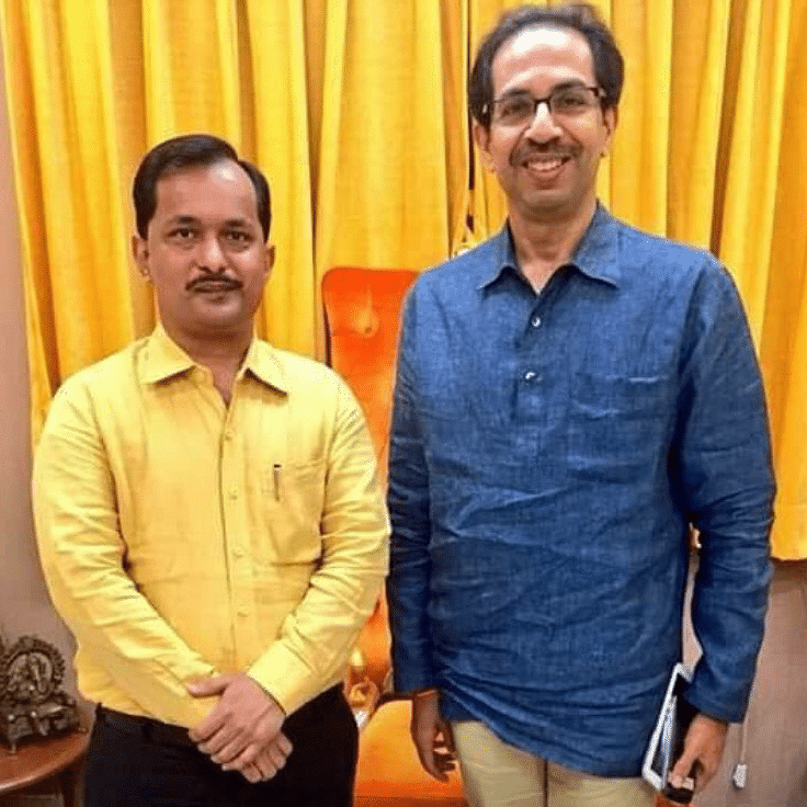 Vinay Shukla with Shiv Sena chief Uddhav Thackeray.
