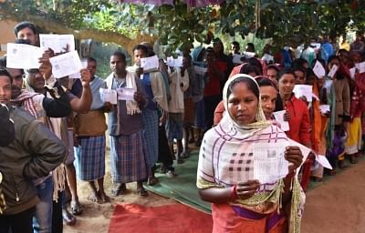 Konta: Voters queue up outside a polling booth during the 1st phase of Chhattisgarh Assembly Elections in Konta on Nov 12, 2018. (Photo: IANS/PIB)