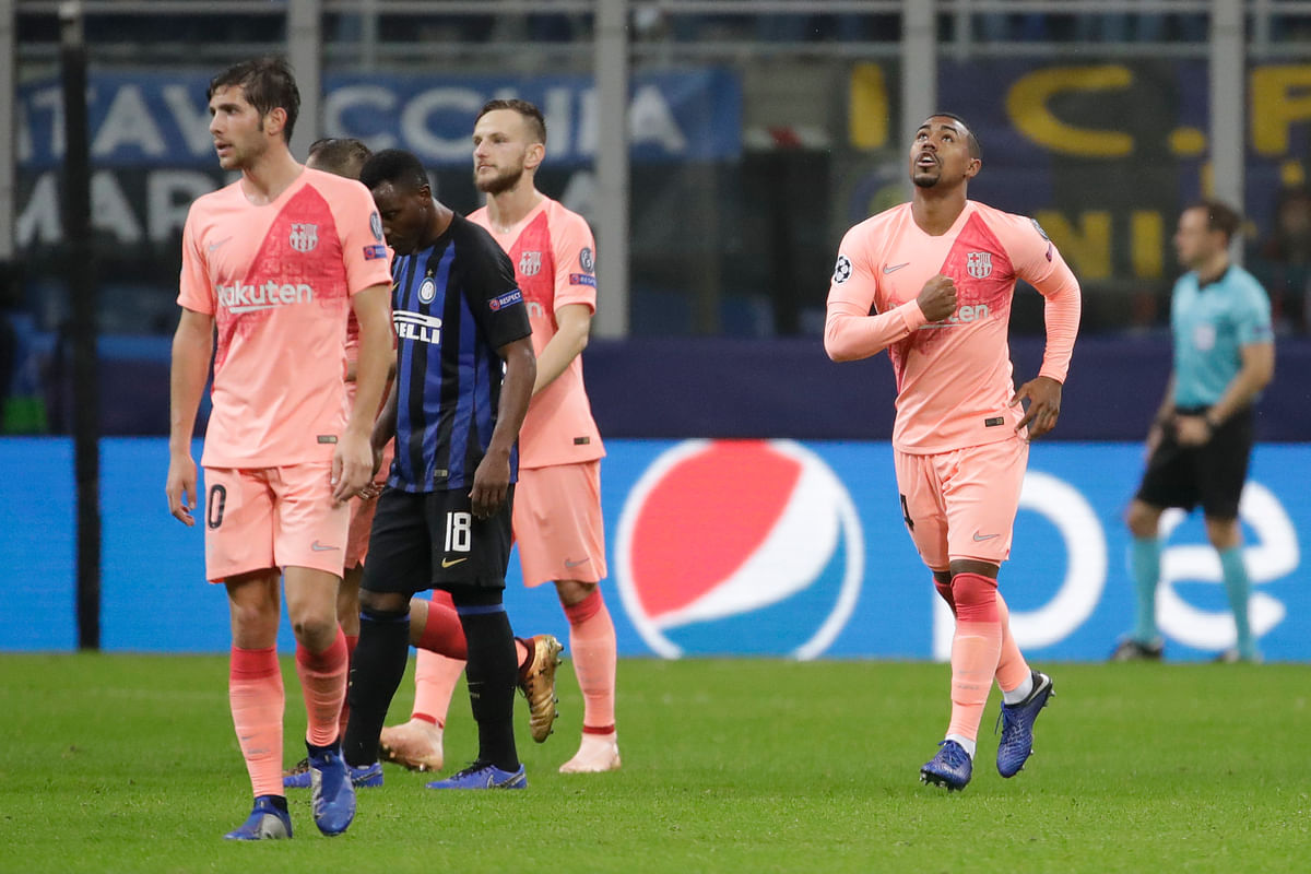 Malcom (right) celebrates after scoring Barcelona's opening goal vs Inter Milan