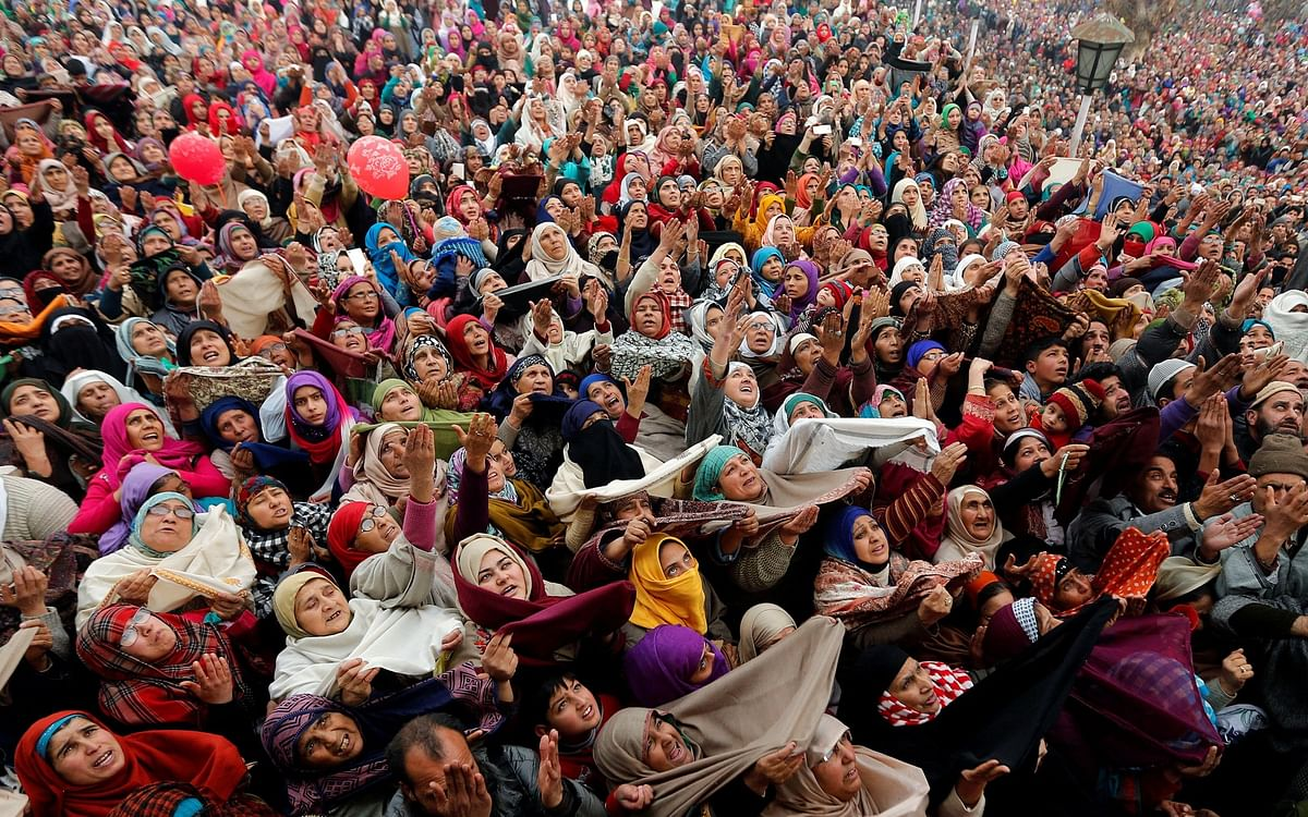 People react upon seeing a relic believed to be a hair from the beard of Prophet Mohammed, on the festival of Eid-e-Milad-ul-Nabi at the Hazratbal shrine in Srinagar.