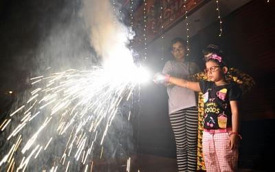 Kolkata: Children burst firecrackers during Kali Puja celebrations in Kolkata, on Nov 6, 2018. (Photo: Kuntal Chakrabarty/IANS)