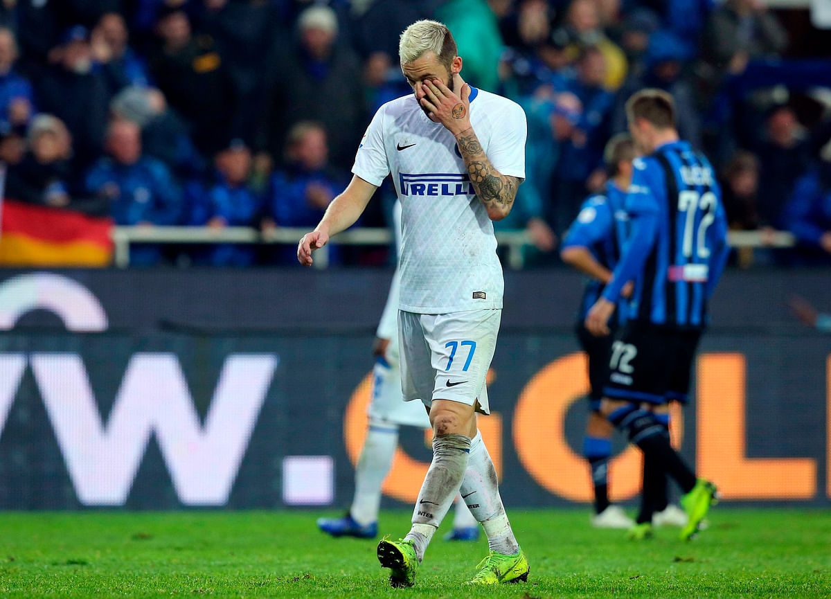 Inter Milan's Marcelo Brozovic walks off after being red-carded against Atalanta