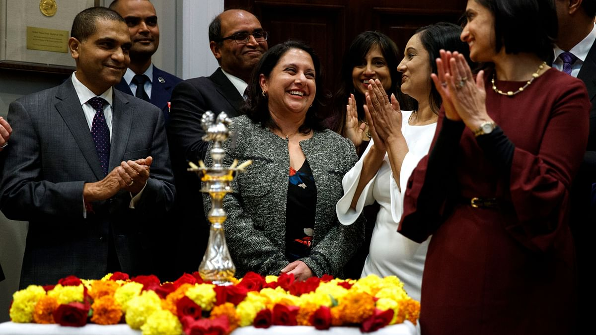 Neomi Rao smiles as US President Donald Trump announces his intention to nominate her to fill Brett Kavanaugh's seat on the US Court of Appeals for the DC Circuit.