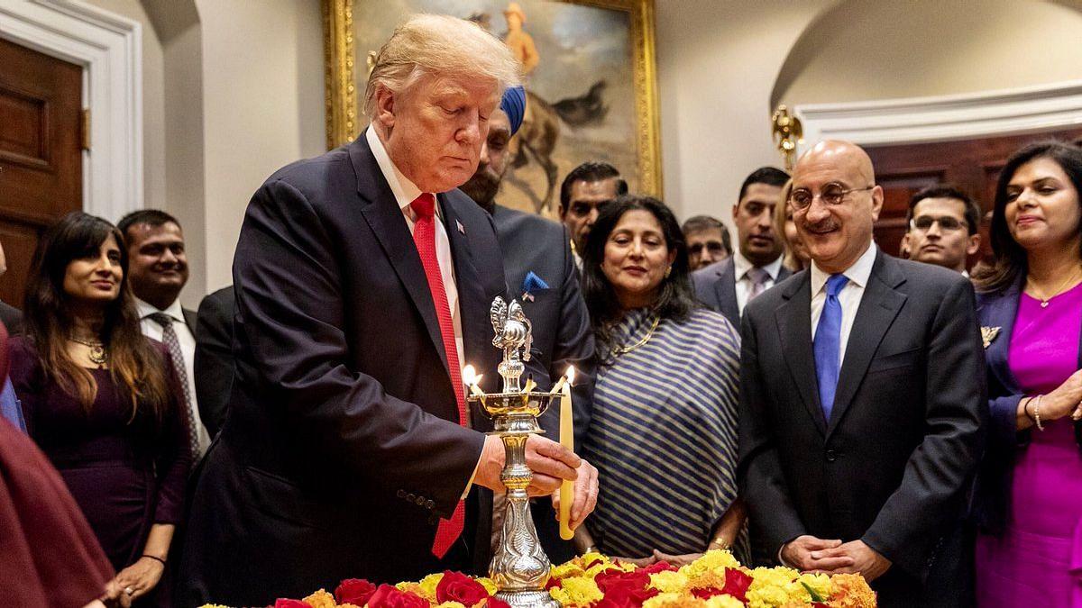 US President Donald Trump celebrates