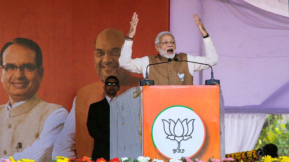 PM Modi addresses a rally in Rewa, ahead of Madhya Pradesh Assembly elections, Tuesday, 20 November.
