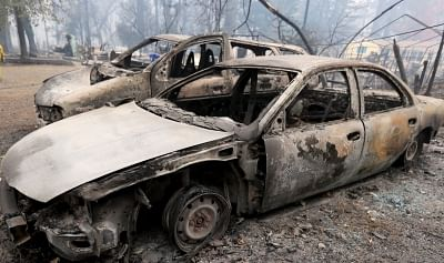 PARADISE, Nov. 14, 2018 (Xinhua) -- Destroyed cars are seen after the wildfire in Paradise, California, the United States, on Nov. 13, 2018. The death toll from the raging Camp Fire in the U.S. state of California has increased to 48 as rescuers continue to search for missing residents in and around the town of Paradise, local authorities said Tuesday. (Xinhua/Li Ying/IANS)