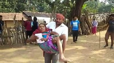 Sukma: A senior citizen being assisted to a polling booth by her family member during the first phase of Chhattisgarh Assembly election, in Sukma on Nov 12, 2018. (Photo: IANS)