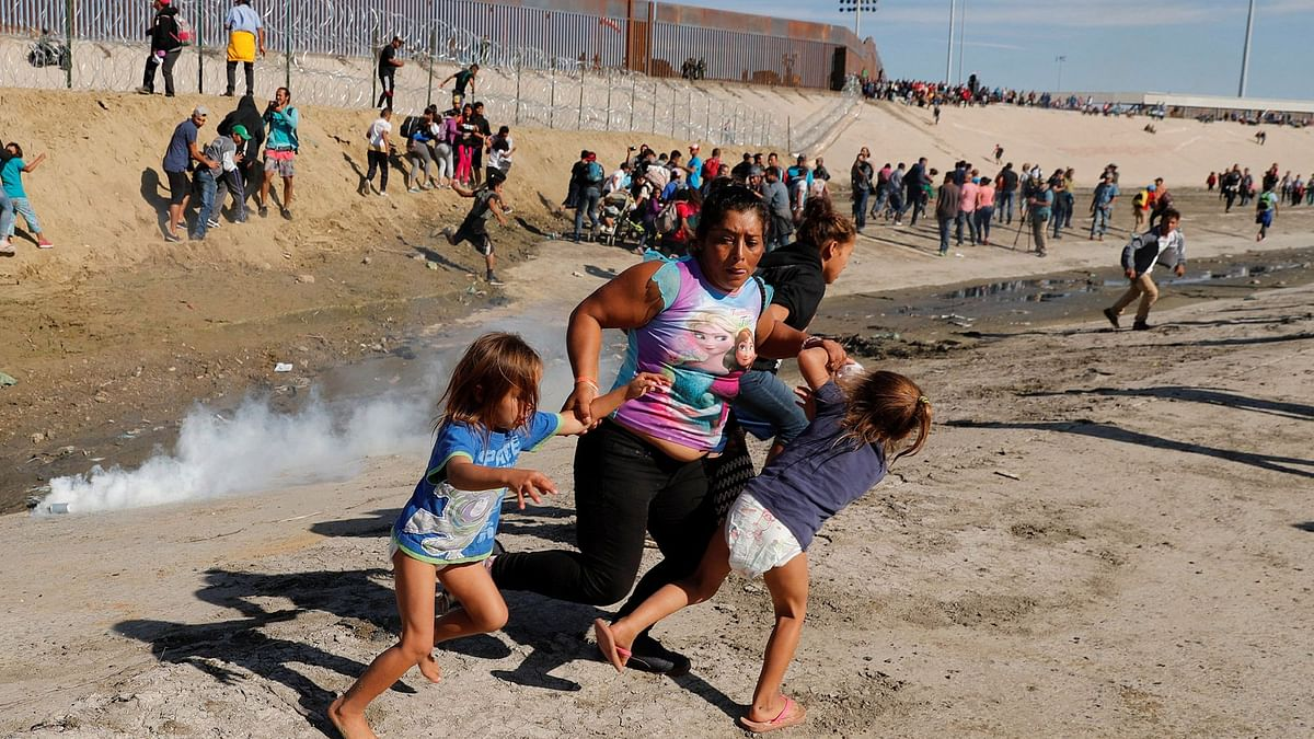 Migrants Tear-Gassed After Allegedly Trying To Breach US Border