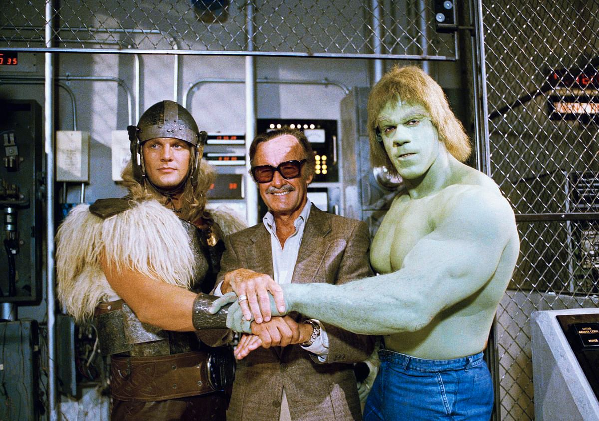 In this 9 May, 1988, file photo, comics impresario Stan Lee, center, poses with Lou Ferrigno, right, and Eric Kramer who portray 'The Incredible Hulk' and Thor, respectively, in a special movie for NBC, 'The Incredible Hulk Returns,' May 9, 1988, Los Angeles, Calif.