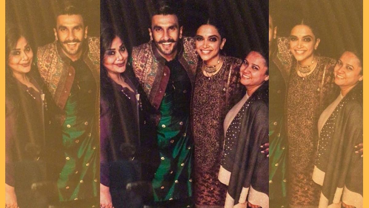 Ranveer Singh and Deepika Padukone with guests at their wedding.
