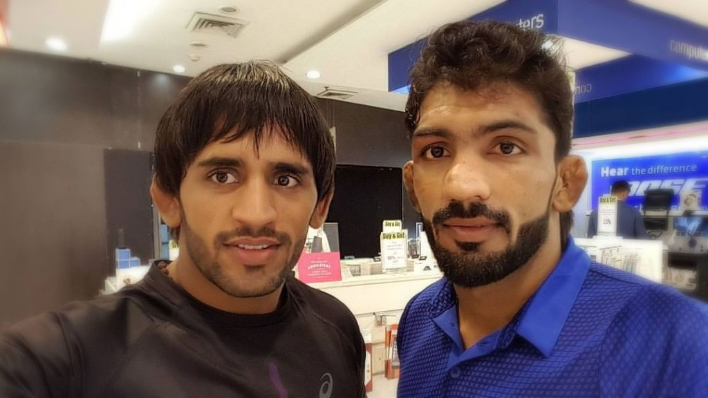 File picture of Yogeshwar Dutt (left) with  Bajrang Punia.