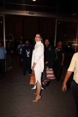 Mumbai: Actress Deepika Padukone arrives at Chhatrapati Shivaji International Airport as she leaves for her wedding with actor Ranveer Singh in Italy; in Mumbai on Nov 10, 2018. (Photo: IANS)
