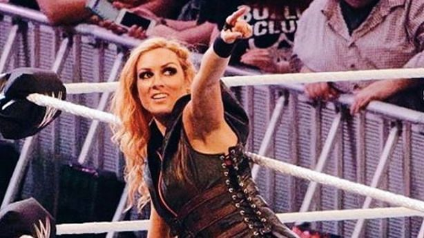 Becky Lynch points to the crowd while entering the ring.