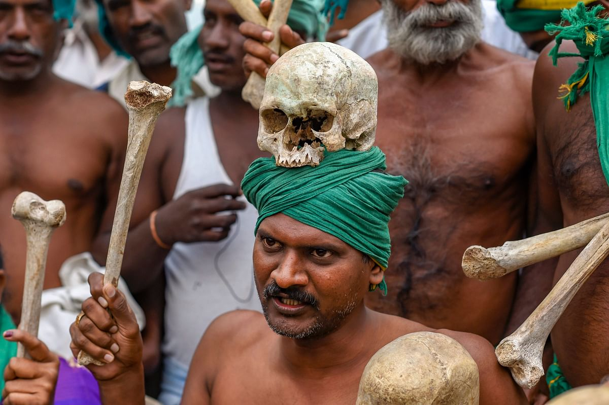 A farmer from Tamil Nadu displays human skulls and bones during a protest ahead of their march towards Parliament, at Ramlila Maidan in New Delhi, Friday, 30 Nov., 2018.