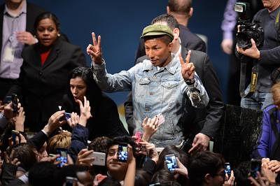 Singer Pharrell Williams (C). (Xinhua/Niu Xiaolei/IANS)
