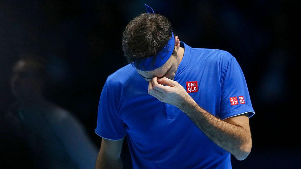 Roger Federer is dejected after losing a point against Alexander Zverev in the ATP Finals semis.