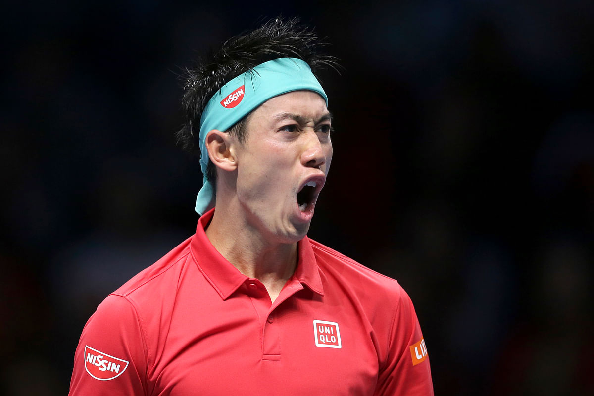 Kei Nishikori celebrates his first win over Roger Federer in seven matches since 2014