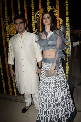Mumbai: Arbaaz Khan with Giorgia Andriani during a Diwali party hosted by Ekta Kapoor at her residence in Juhu, Mumbai on Nov 6, 2018. (Photo: IANS)