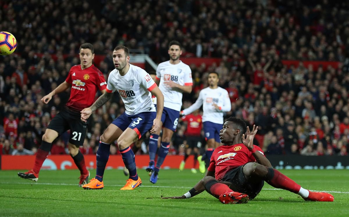 Manchester United's Paul Pogba scores his side's first goal of the game during the Premier League match at Old Trafford, Manchester.