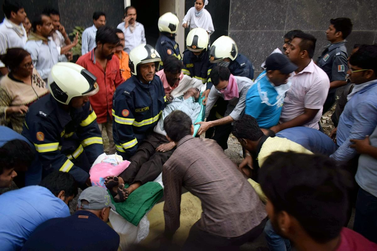 Firefighters conduct rescue after a major fire broke out at ESIC Kamgar Hospital, in Mumbai.