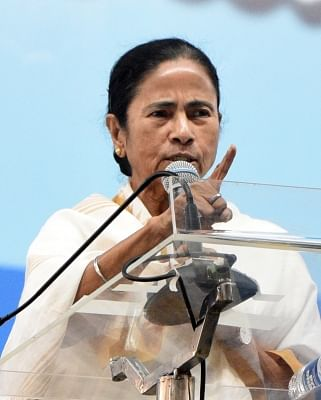 Midnapore: West Bengal Chief Minister Mamata Banerjee addresses during a programme organsied to pay tribute to Khudiram Bose in Midnapore, West Bengal on Dec 3, 2018. (Photo: IANS)