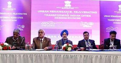 """New Delhi: Union MoS Housing and Urban Affairs Hardeep Singh Puri addresses a press conference on """"Urban Renaissance: Rejuvenating and Transforming Indian Cities"""" in New Delhi, on Dec 31, 2018. Also seen Ministry of Housing and Urban Affairs Secretary, Durga Shanker Mishra and other dignitaries. (Photo: IANS/PIB)"""