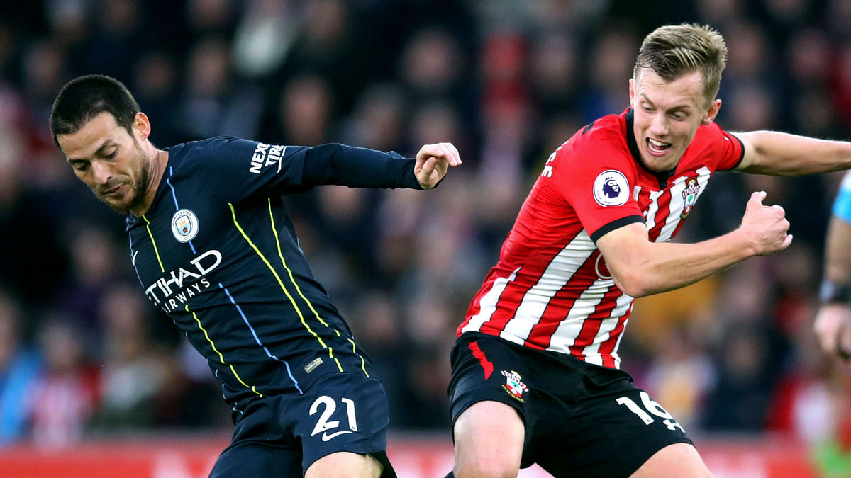 Manchester City's David Silva, left, and Southampton's James Ward-Prowse during their English Premier League soccer match at St Mary's Stadium in Southampton, England, Sunday Dec. 30, 2018.