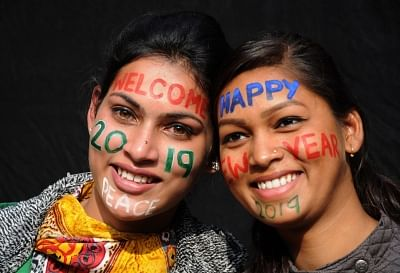Amritsar: People bid adieu to 2018 and welcome 2019 with face paints in Amritsar, on Dec 31, 2018. (Photo: IANS)