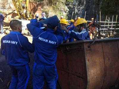Ksan: Navy divers prepare to enter into the illegal coal pit filled with water where 15 miners are trapped inside for 18 days now, in Ksan of Meghalaya