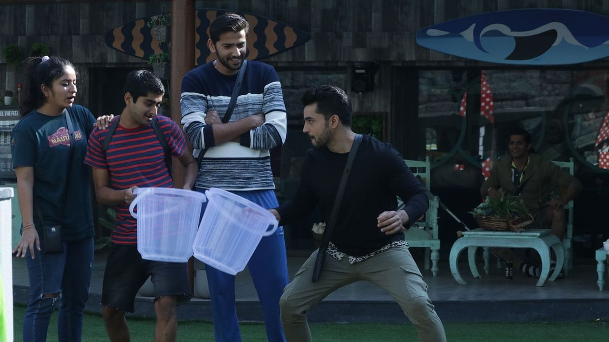 The Bigg Boss contestants compete in the water station task.